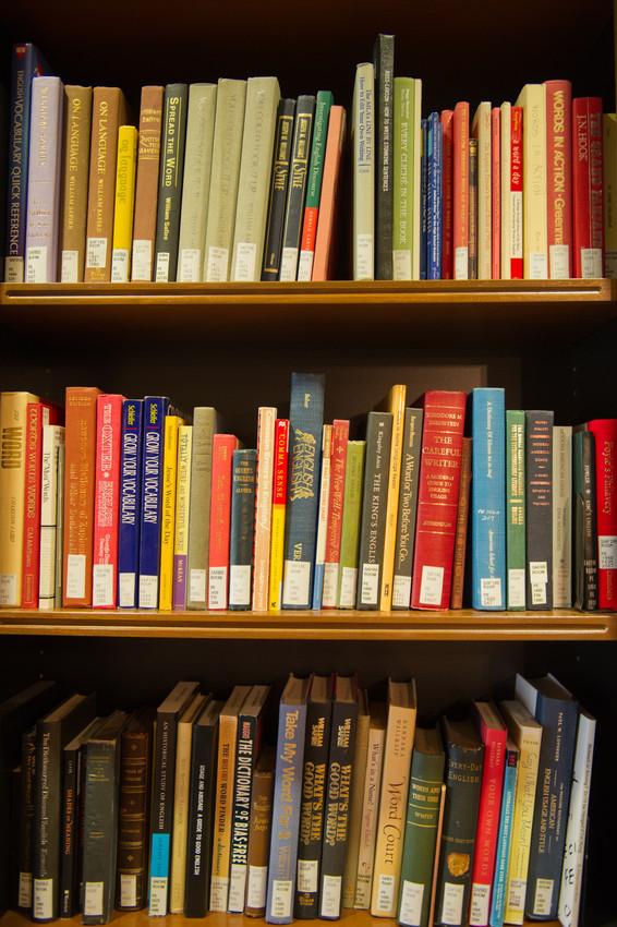 Books on shelves at Syracuse University's Bird Library. Photo by Steve Sartori.