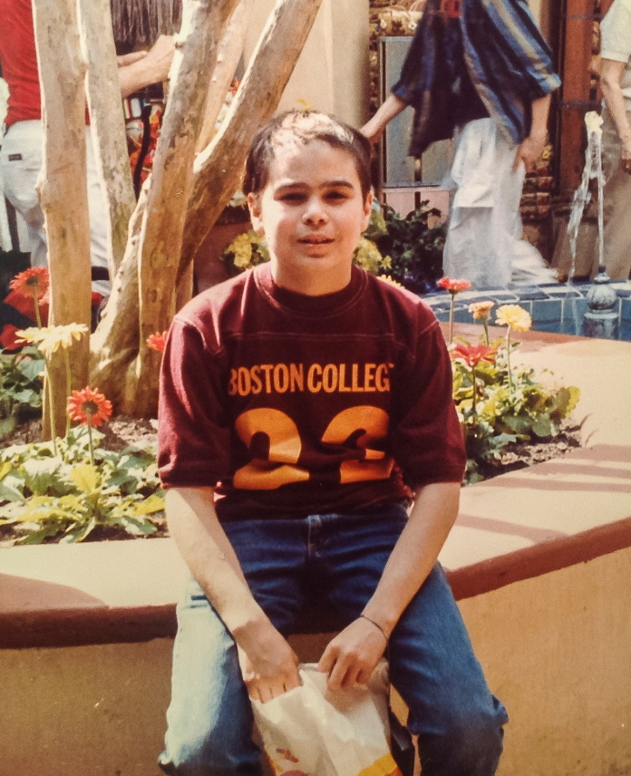 At Disney World in the winter of 1985; the scar from my surgery is visible and my hair has not grown completely back.