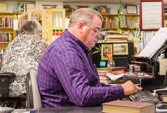 Books End owner Jim Roberts works behind the counter.