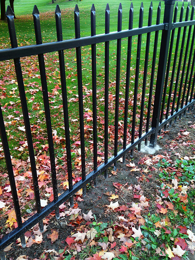 A fence located on South Crouse Avenue near an apartment building serving senior citizens.