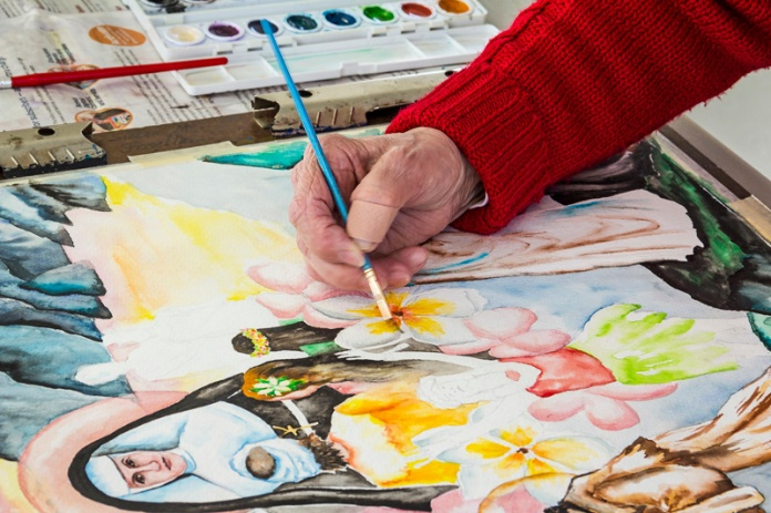 Close-up of Sister Joselle Orlando working on a watercolor piece. Photo by Francis DiClemente.