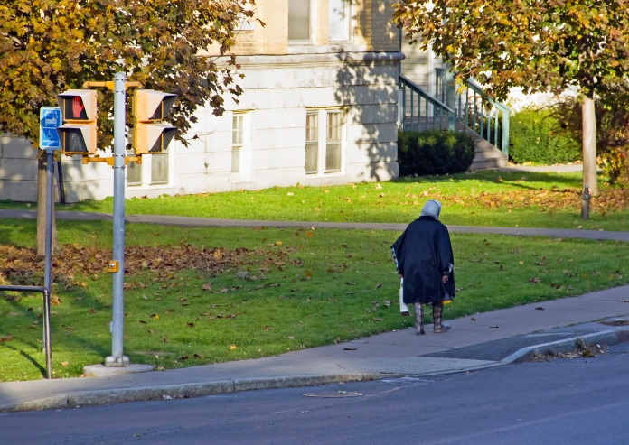 Woman walking along Genesee Street in Syracuse, New York. I snapped this photo a few years ago while standing on the front porch of my apartment building, while testing out my new Canon DSLR.