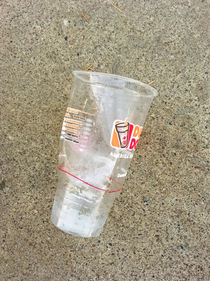 Dunkin' Donuts cup on the sidewalk (not staged or rearranged).