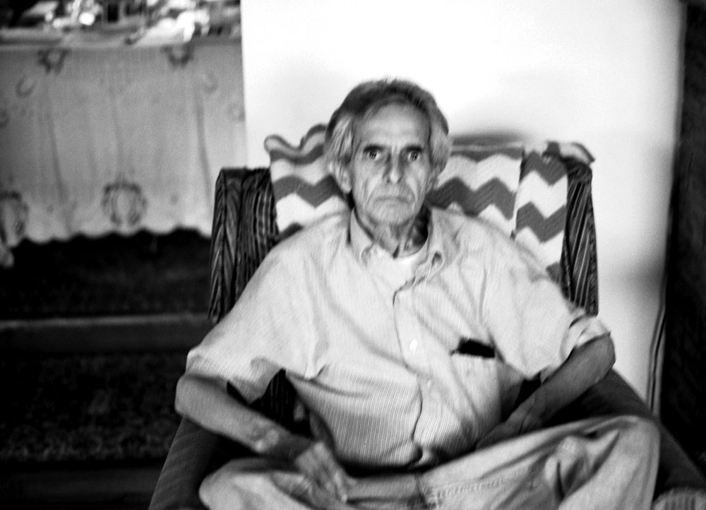 Dad in his chair. It's out of focus, but I love how he looks directly at the camera. Photo by Francis DiClemente.